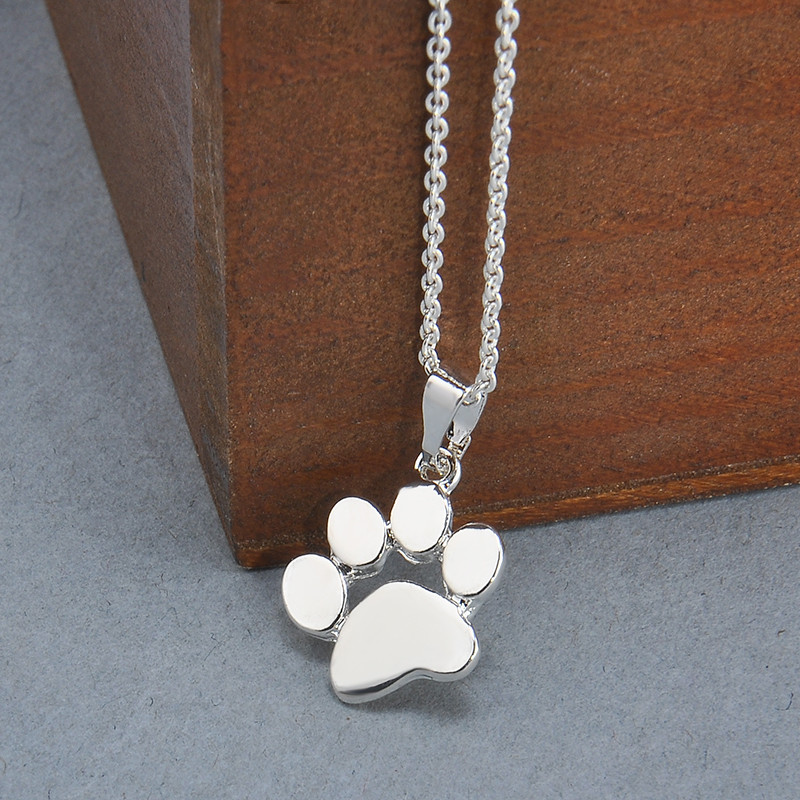 filigree asp paw print dog medium solid silver necklace drop p